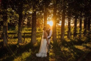 Intimate moment for newly married couple as the sun sets.
