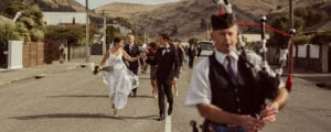 Wedding ceremony procession with bagpipe player