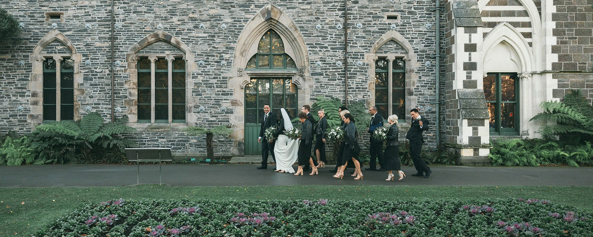 Bridal Party walking past museum
